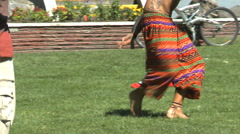 Dancing at festival, barefoot hippies, no faces Stock Footage