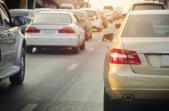 Traffic jam with rows of cars during rush hour on road Stock Photos