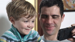 Father comes home and plays with his son, joy Stock Footage