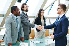 Stock Photo of Handshaking after negotiation