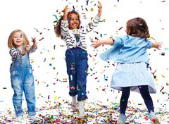 Playing with confetti - stock photo
