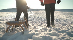 Back view walking legs with toboggan Stock Footage