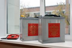 Mobile ballot box to vote in the elections outside with coat of arms Russia Stock Photos