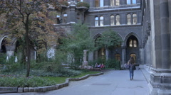 Walking in the courtyard of Rathaus, Vienna Stock Footage