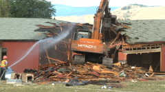 Building demolition, crunching through the roof Stock Footage