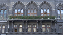 Gothic windows and balcony on the facade of Rathaus, Vienna Stock Footage