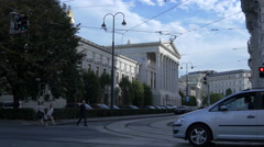 Driving cars and walking on next to the Austrian Parliament Building, Vienna Stock Footage