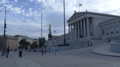 Walking in front of the Austrian Parliament Building, Vienna Stock Footage