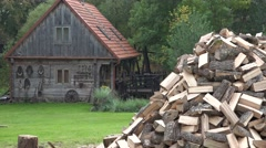 Rural retro house and firewood pile in village. Focus change. 4K Stock Footage