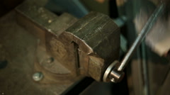 Man sawing with a manual hacksaw the pipe, gripped in a vise Stock Footage