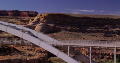 Motorcycle crossing bridge over the Colorado River, Glenn Canyon Stock Footage