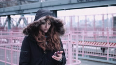 Commuter on street in New York looking at smart phone Stock Footage