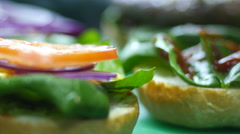 Cooking hamburger - ingredients are fresh vegetables and grilled meat Stock Footage
