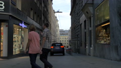 Walking on Mariahilfer Straße cross to Königsklostergasse, Vienna Stock Footage
