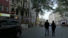 People walking and riding bikes on Mariahilfer Straße, Vienna Stock Footage