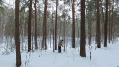 Skier running down the Siberian snow-covered forest Stock Footage