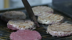 Cook fries hamburger meat on the grill Stock Footage