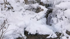 Freezes falls from the walls of the quarry and stream - stock footage