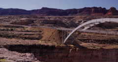 Truck crossing bridge over the Colorado River, Glenn Canyon, Utah Stock Footage