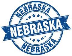 Nebraska blue round grunge vintage ribbon stamp - stock illustration