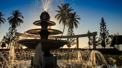 camera moves around cascade fountain changing jets in park - stock footage