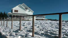 White hotel in the mountain, winter time Stock Footage