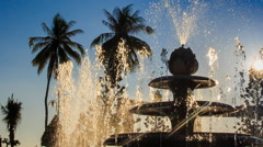 Upper jet of round cascade fountain sprays in tropical park Stock Footage