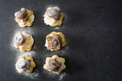 Fresh profiteroles with cream and chocolate frosting Stock Photos