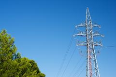 Power line with clear blue sky - stock photo