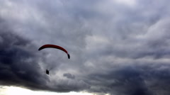 Paraglider silhouetted in sun Stock Footage