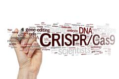 Stock Illustration of Hand writing CRISPR/Cas9 system for editing, regulating and targeting genomes