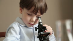 Small scientist with a microscope Stock Footage