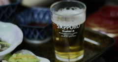 Hokkaido, Japan - Traditional Japanese guest house serving a beer Stock Footage