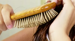 Closeup of long hair being brushed Stock Footage