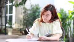 Thai adult beautiful girl write a book. Stock Footage