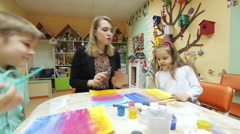 Children drawing in classroom - stock footage