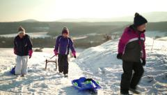 little girls walking with their sleds - stock footage