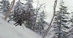 Hokkaido, Japan - Skier descending in powder snow. Stock Footage