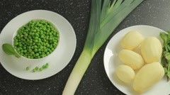 Ingredients for vegetarian soup: potato, pea, leek, mint Stock Footage