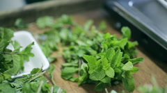 Pack of mint leaves into a container. Distributors of food. Stock Footage