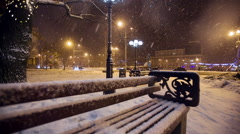 Snow falls in a christmass city - stock footage