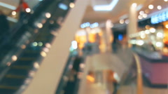 Blurred background window boutique shop with glowing lights and motion escalator Stock Footage