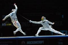 Two athletes fencing at tournament Stock Photos