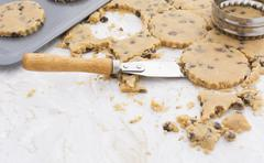 Cutting cookie dough and lifting with a palette knife - stock photo