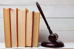 Law book with wooden judges gavel on table in a courtroom or law enforcement Stock Photos