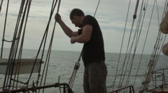 Stock Video Footage of A crew member works on the deck of a tall ship in the Canary Islands
