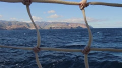La Gomera Island seen through nets on a tall ship in the Canary islands Stock Footage