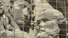 Close up view of the faces sculpted on the facade of Stephansdom, Vienna Stock Footage