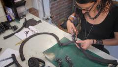 Jewelry maker making holes slide Stock Footage