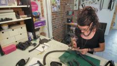 Jewelry maker making holes wide slide Stock Footage